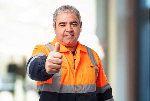 Happy worker with thumb up